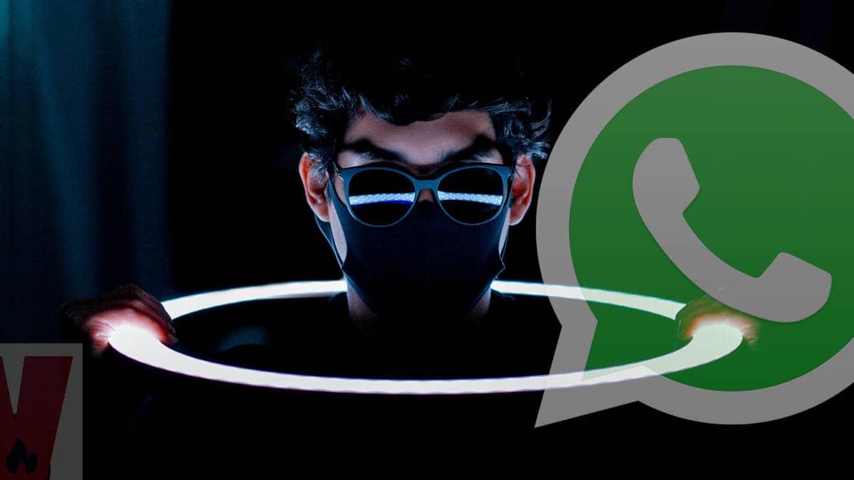 WhatsApp hackerato persona con occhiali da sole e cerchio luminoso